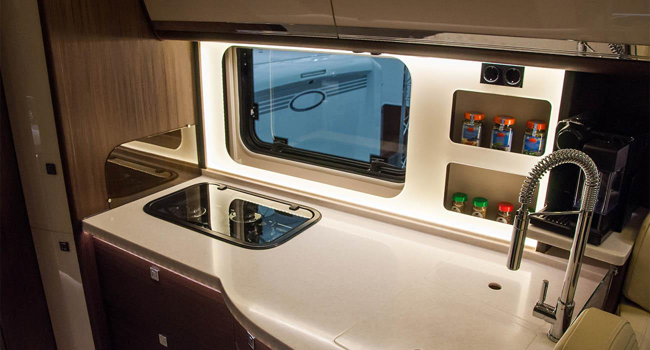 Interior of luxury caravan. Detail photo of coach with luxury equipment